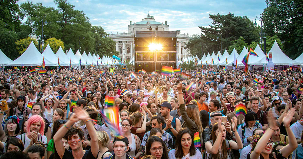 Crowds of people at EuroPride decorated in rainbow colours