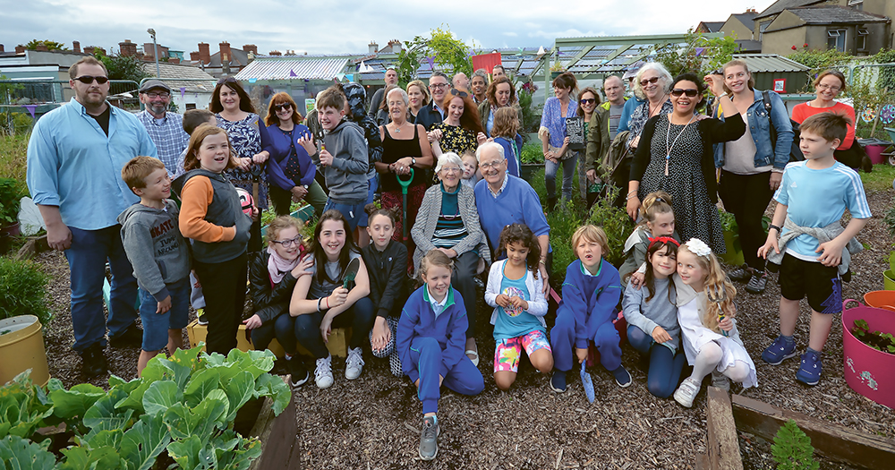 A group of people posing together in Mud Island - one of the community gardens in Dublin city centre