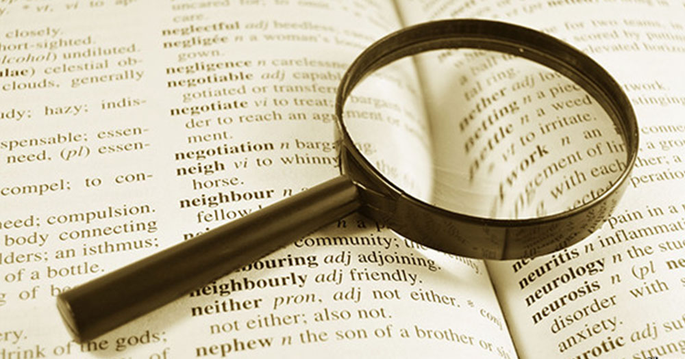 Merriam dictionary with magnifying glass