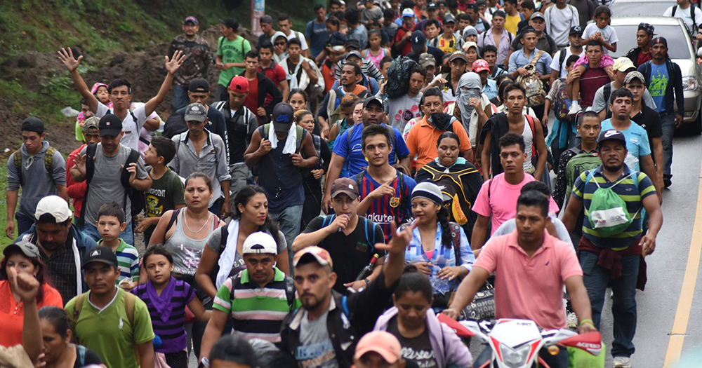 A migrant caravan from Honduras makes its way down a road