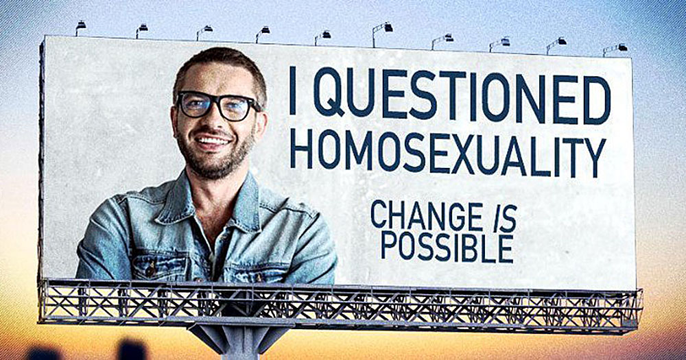 "Legal bans have not stopped forms of conversion therapy such as that promoted by this poster, reading ""I questioned homosexuality. Change is possible."""