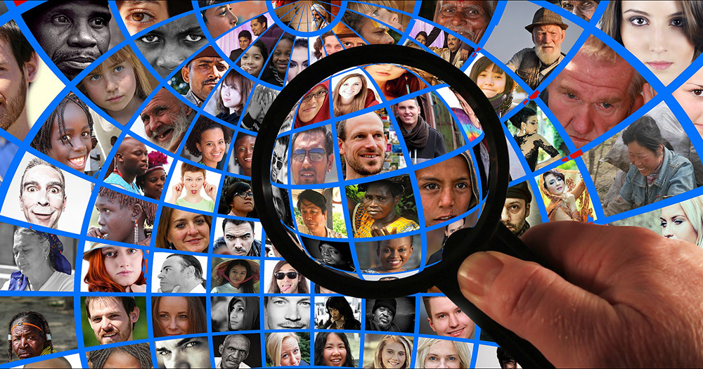 Sexual orientation question considered for 2026 census. Here, a magnifying glass is held up against a collection of faces.