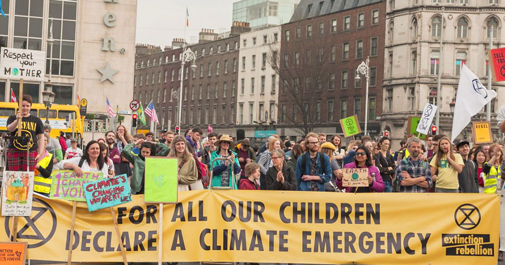 A group of protestors calling for the government to declare climate emergency