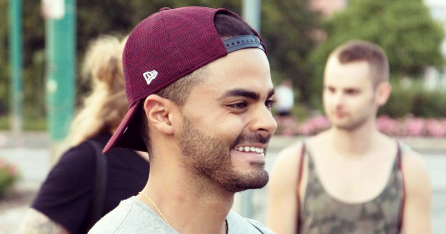 Mr Gay Ireland Guilherme Souza wearing a cap smiling. In this interview, Guil details his journey away from self-guilt as an abuse survivor.