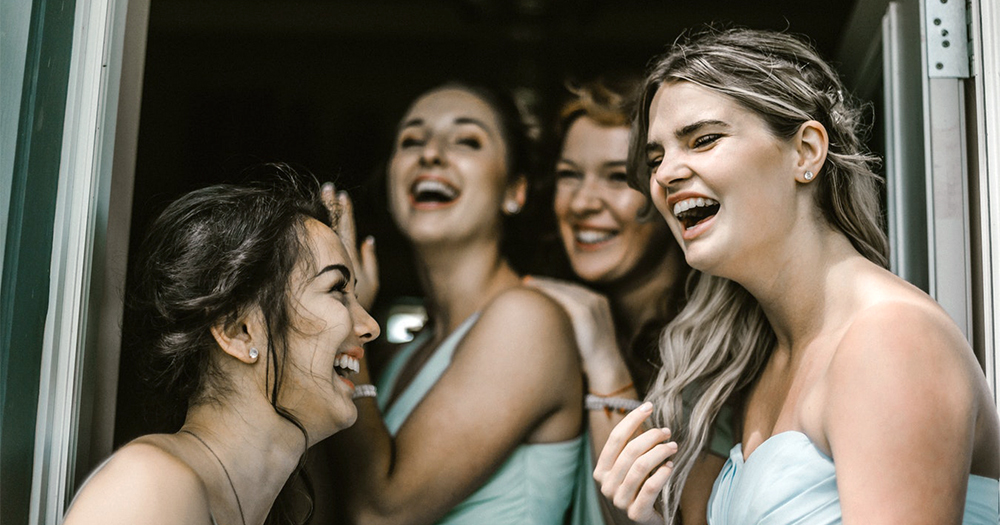 Girls laughing. In this opinion piece we talk about why people should stop saying that's gay