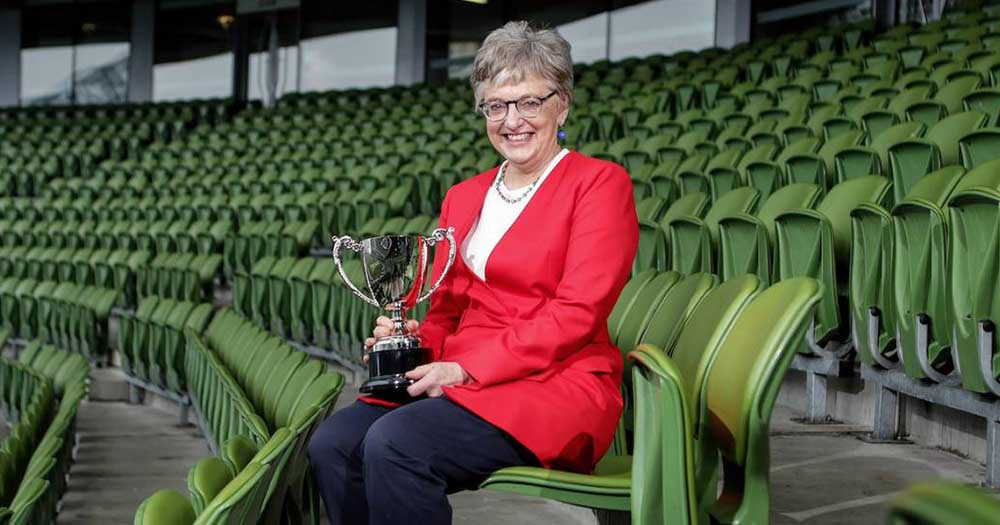 At the Union Cup launch, Katherine Zappone sits in the stands at the Aviva Stadium holding a trophy