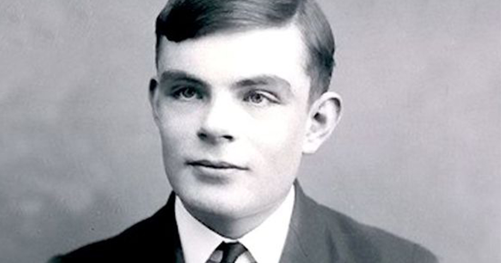 Black and white photo of Alan Turing