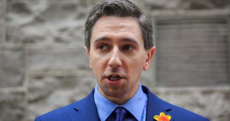 simon harris stand in front of building PrEP