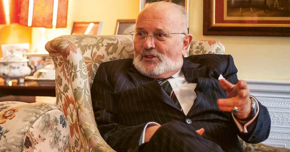 Senator David Norris in his living room speaking and gesturing with his hands