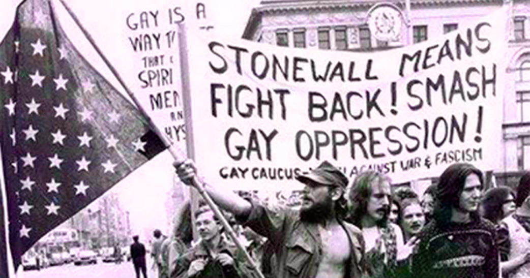 "Protestors holding a banner that reads "" Stonewall means fight back! Smash gay oppression!"""