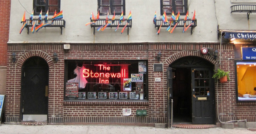 Front of Stonewall Inn in New York with Pride Flags