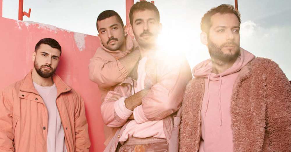 Members of Mashrou Leila wearing all pink