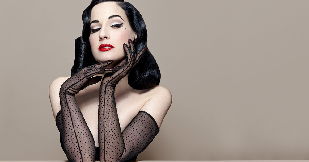 Dita Von Teese in front of blank background