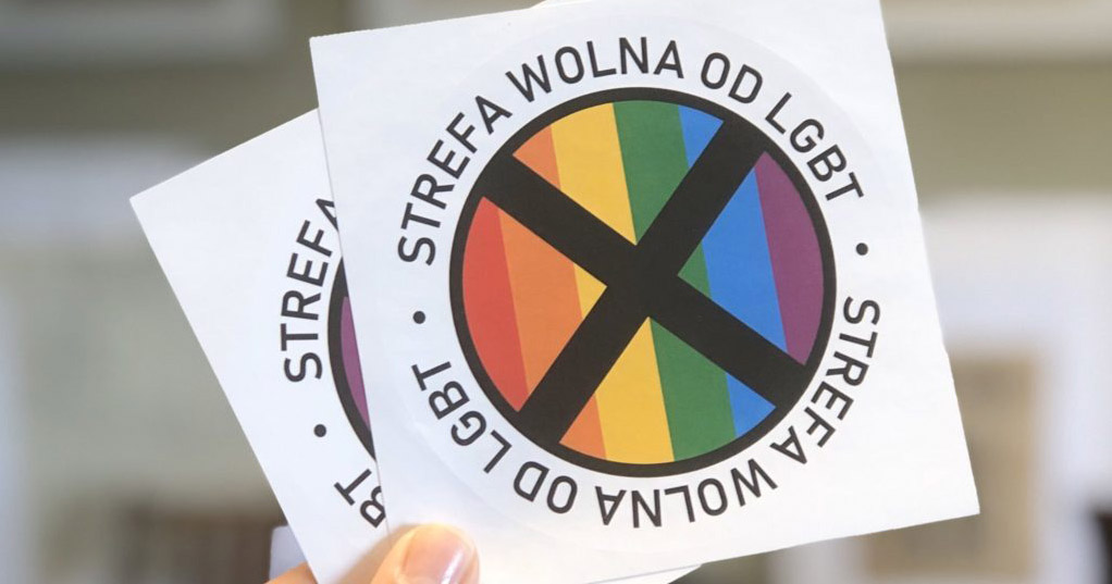 'LGBT-Free Zone' sticker featuring a black cross over a pride flag