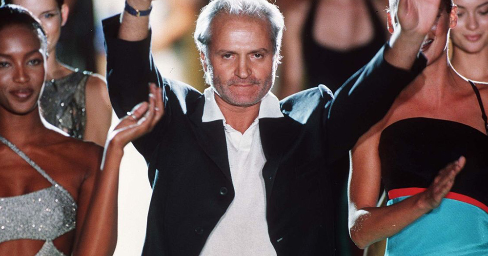 Gianni Versace celebrates after fashion show