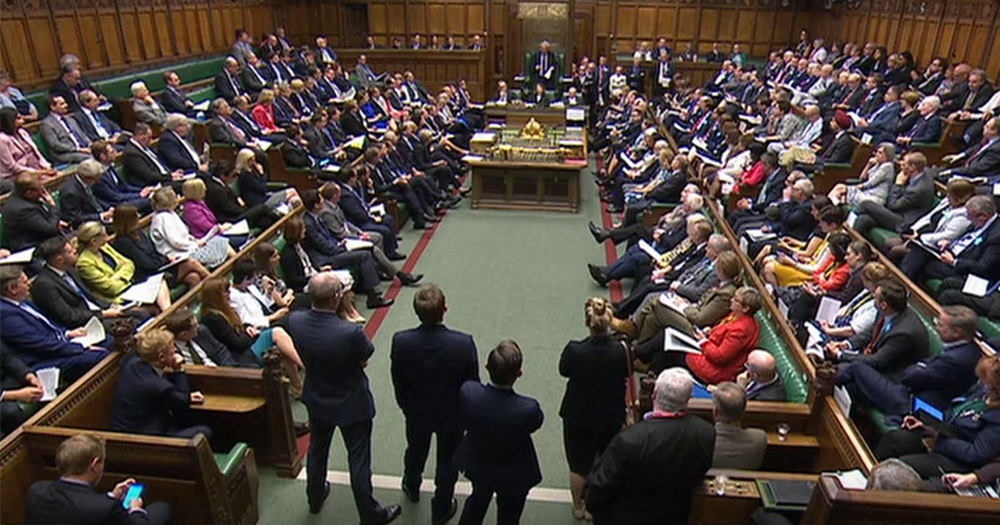 The House of Commons parliament, the seats filled with MPs