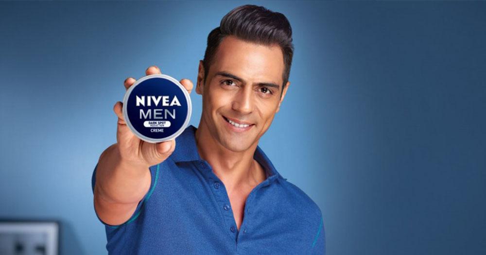 man holding Nivea product