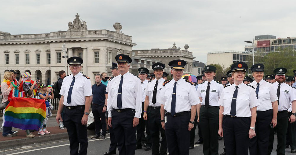 PSNI Officers marching at Dublin Pride Parade 2019 with pride flag in background