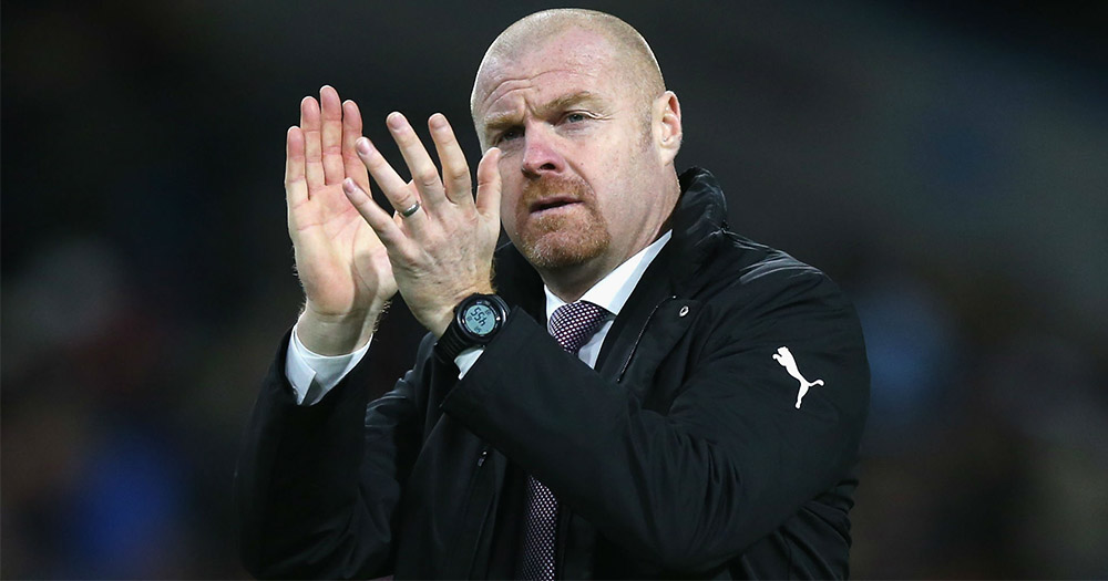 Sean Dyche claps when watching a football match