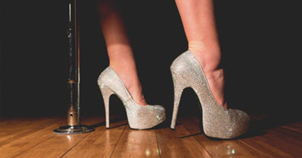 Strip club Glittery stilettos beside a dancing pole