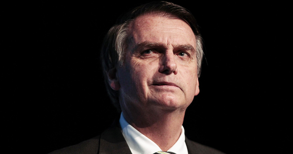 President Bolsonaro looking threatening against a black background
