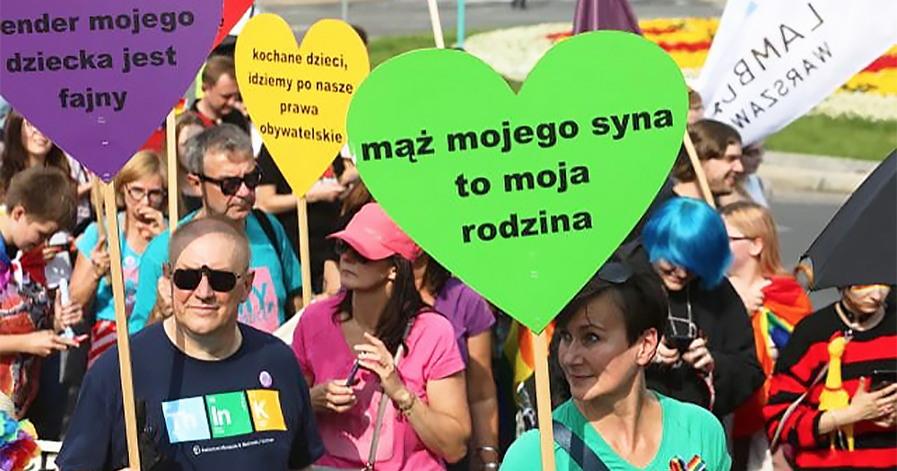 Family and members of LGBT+ community holding heart signs in Poland. Recently Polish newspaper Gazeta Polska has come under fire for distributing anti-LGBT stickers