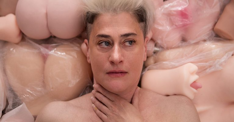 Peaches lying on top of a variety of flesh toys and Mastubators as a promotional poster for Whose Jizz Is This?
