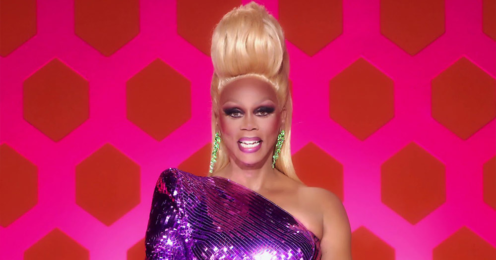 RuPaul announcing season 12 of Drag and All Stars 5 in a purple dress.