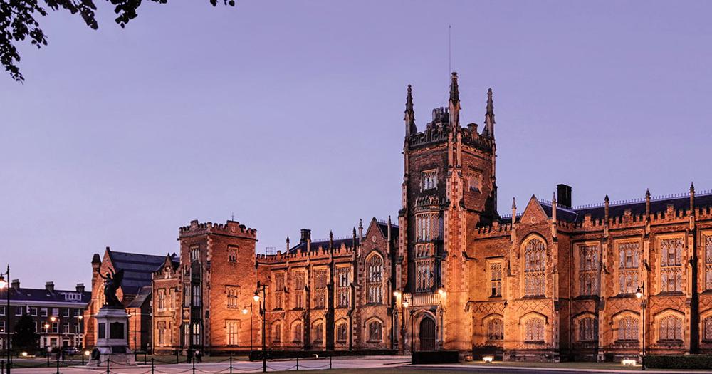 The exterior of Queen's University Belfast in the evening