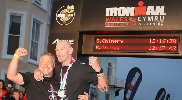 Gareth Thomas with his husband at the finish line hours after revealing he is HIV Positive
