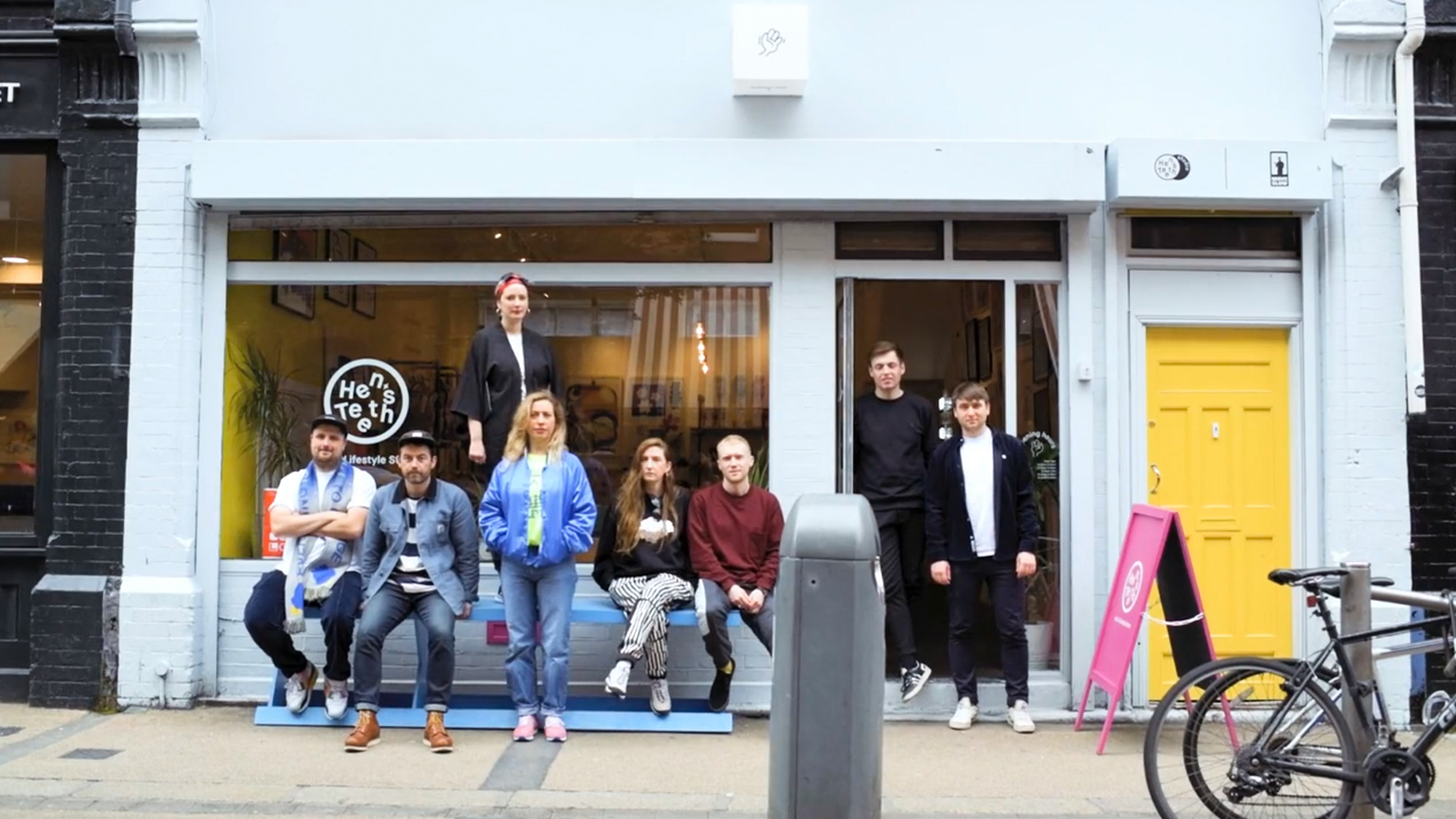 Hen's Teeth team stand outside their previous home on Fade Street