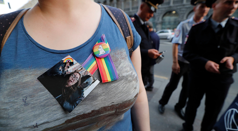 Person wears badge of Yelena Grigoryeva
