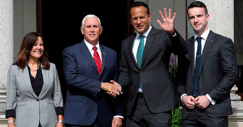 Pence and Varadkar pictured with their partners shaking hands outside Farmleigh House during Pence's visit to Ireland