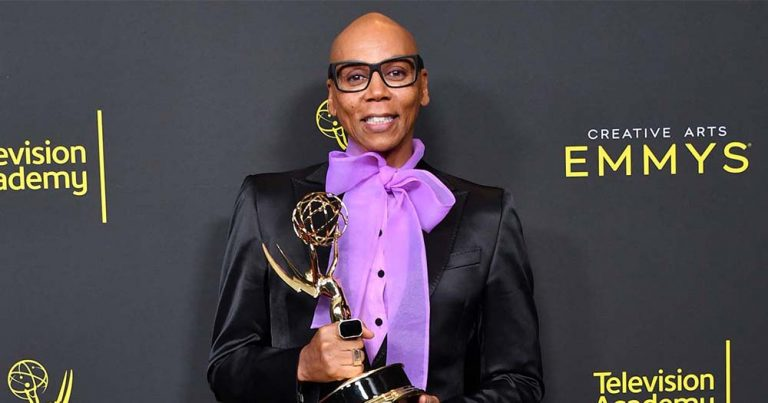 RuPaul, one of the Emmy winners dressed well holding an award