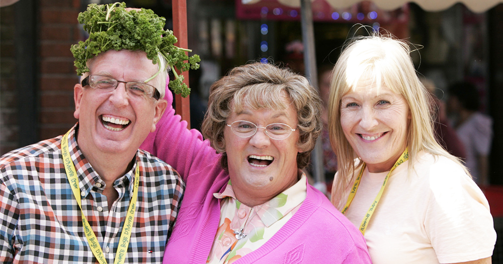 Rory Cowan, Brendan O'Carroll and Jennifer Gibney pose beside a vegetable stall