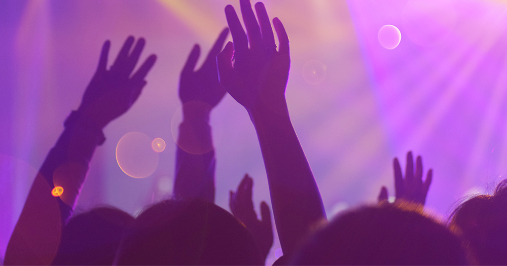 Hands raised in the air at a nightclub