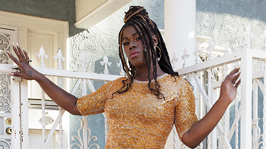 One of the singers of colour that should be on your playlist: Shea Diamond in a yellow dress