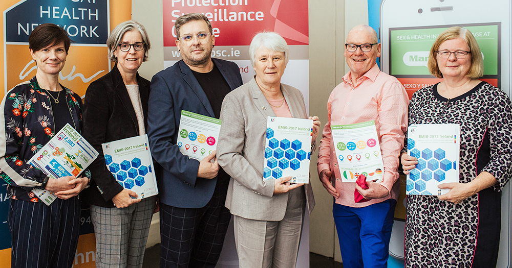 The EMIS report launch with four women and two men holding up a copy of the published report
