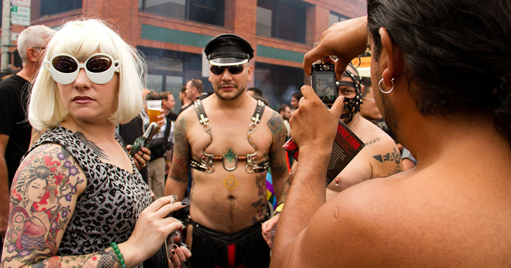Woman wearing alien eyed glasses at Folsom Street Fair 2019.