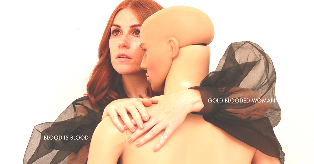 Gold Blooded Woman posing with the mannequin for promotional image of 'Blood is Blood'.