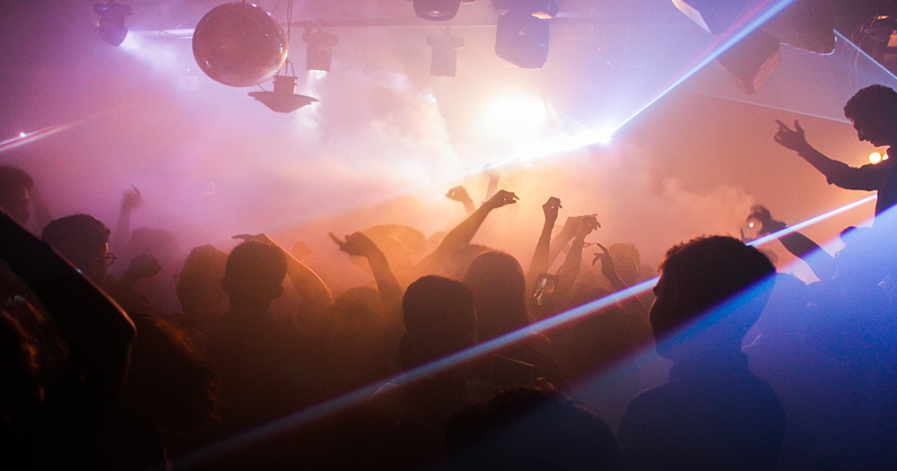 People dancing in a busy nightclub