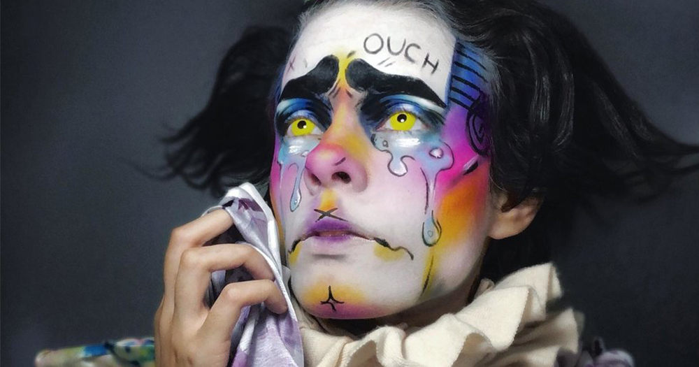 A drag king with a face painted to look like a crying clown