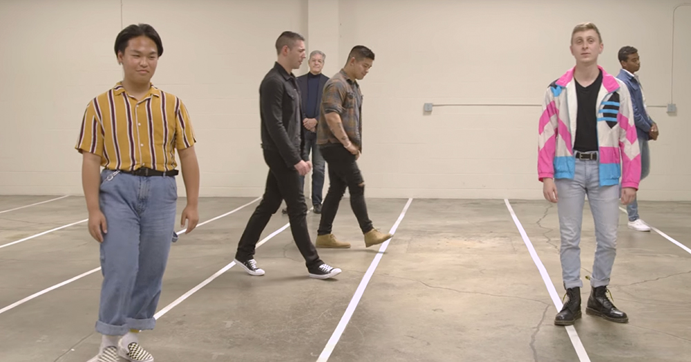 Men walking to different lines drawn on a concrete floor