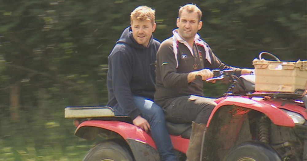 Gay farmer Ben Lewis and his partner Frazer on a red quad bike