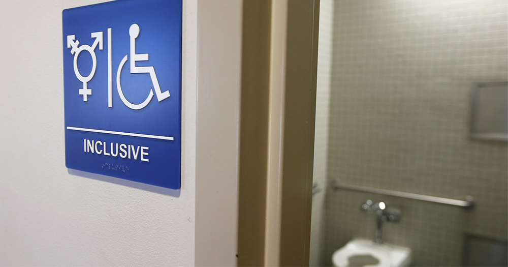 A gender neutral sign outside a bathroom
