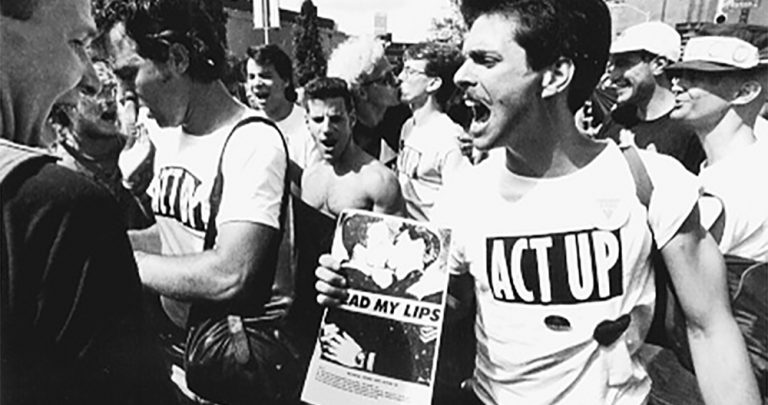 Men wearing Act Up t-shirts at an HIV/AIDS demonsration