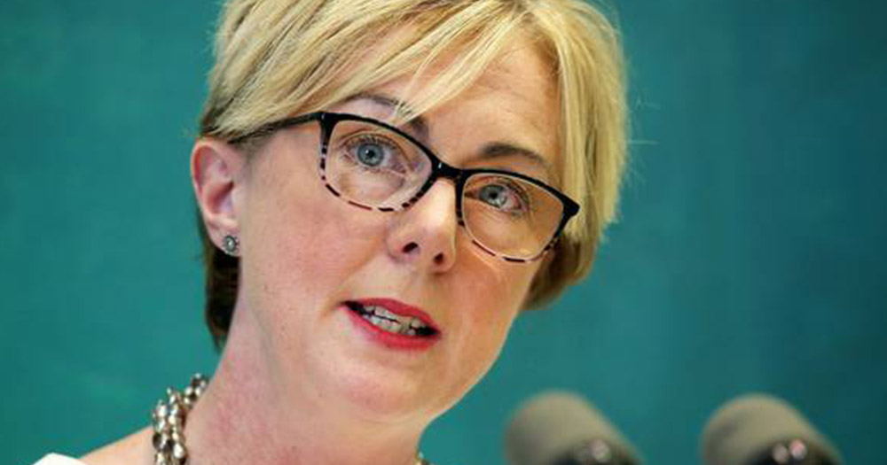 Minister for Social Protection Regina Doherty speaking into a microphone, she introduced the changes to the Gender Recognition Bill.