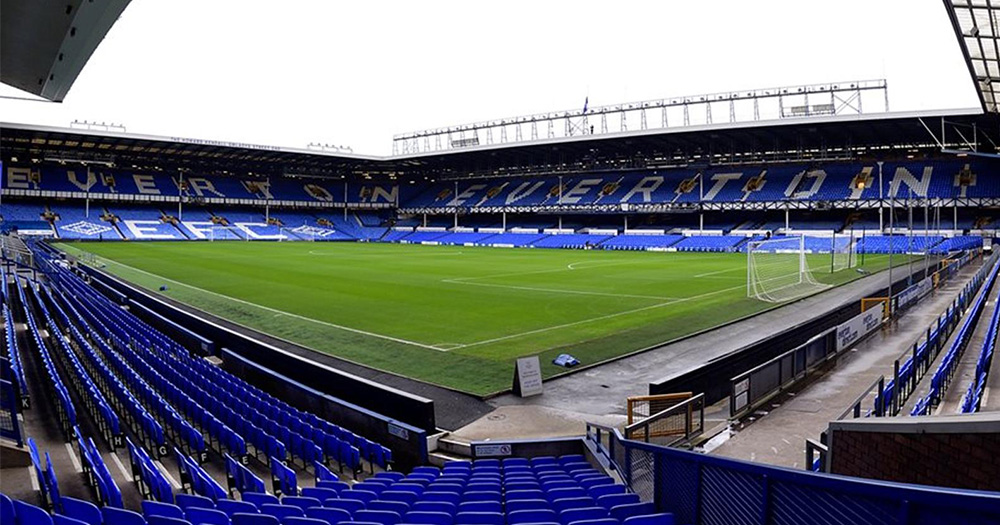 Everton FC stadium, the pitch and the hundreds of seats are empty