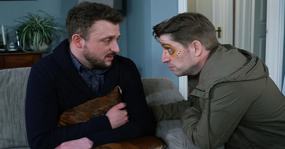 Fair City character Cristiano holds pillow as abusive boyfriend Will intimidates him