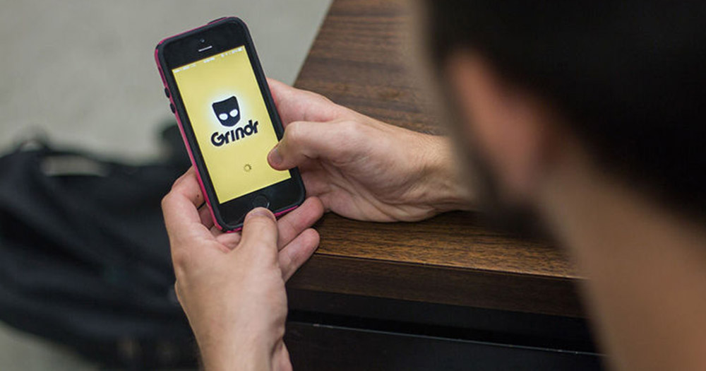 Person on Grindr, a dating app which recently announced new security features.